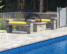 This beautiful New York backyard was created by Triumph Pavers using the following products: Pavingstones: The Sherwood Collection, Ledgestone XL in Limestone Quarry Blend Wall System: Olde English Wall System in Limestone Quarry Blend Fire Pit: Pre-Packaged Cambridge Olde English Square Fire Pit Kit Water Feature: Cambridge Rectangular Pre-Packaged Waterfall Kit