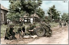 German SS gunners (probably 1st SS-Pz.Div. LSSAH) man a 7.5cm le.IG 18 during the Battle of Uman.