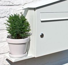 incredible!! a mailbox that waters a plant with rainwater. cute!