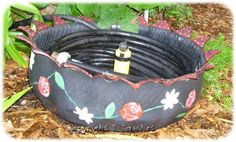 Painted+Tire+Planters | An old tire planter I painted. I use it to hold my hose. | Gardening