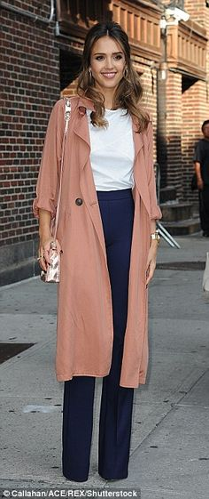 Just peachy: Covering up her incredible figure in the loose-fitting ensemble…