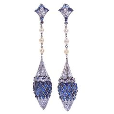 France.  Art Deco period, Dangling diamond and sapphire inlaid platinum earrings with pearl strands.