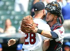 Corey Kluber gets a hug from catcher Yan Gomes after Kluber pitched a complete game victory over the Kansas City Royals on July 29, 2015 at Progressive Field.  (Chuck Crow/The Plain Dealer)