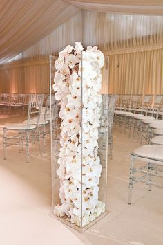 Trailing phalaenopsis orchid heads were displayed at the ceremony