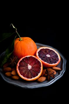 Blood Orange ...beautiful and delicious. there is a recipe for an orange tart, but i repinned this for the love of this gothy fruit and of the gorgeous pic!