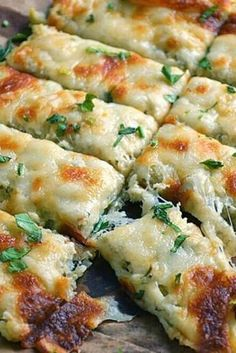 LOW CARB CAULIFLOWER BREADSTICKS From Real Housemoms are Number 5 on our list :: Click HERE for the RECIPE Low Carb Cauliflower Breadsticks with fresh herbs, garlic, and lots of ooey gooey cheese atop a cauliflower crust looks and tastes like cheesy bread! #cheese #cheesy #cauliflower #healthy #breadsticks #dinner #appetizer