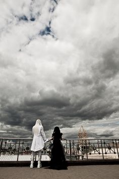 bride and groom are watching the sky goth wedding