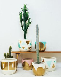 DIY geometric and gold cacti pots. For more DIY tutorial and inspiration, visit www.designisyay.com