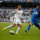 Cristiano Ronaldo taking on a defender.