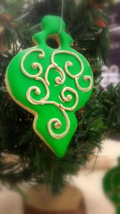 Green Christmas Ornament Sugar Cookie.  Crisp, buttery and individually hand decorated so no two are exactly alike.