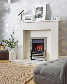 To capture the mood of 'hygge' light a fire and relax on your sofa with lots of cushions and throws.