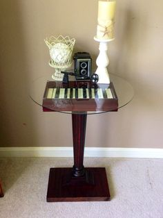 piano keys table reusing the keys, base wood, and ornate pedestal from a 1920's upright piano by MusicAsArtBySarah on Etsy
