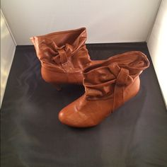 Cute brown booties with bows!! Brown booties with bow and low heel. Very cute with skinny jeans or skirts and tights. Worn twice. Shoes Ankle Boots & Booties