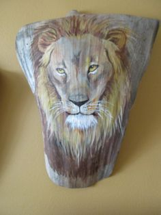 Lion painted on large royal palm ready to hang on your wall.