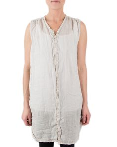 The sleeveless button down linen Karla from CP Shades features a high shirttail hem on the sides & a gathered back. Worn loose and flowy – this top looks great paired with leggings or over a fitted dress!