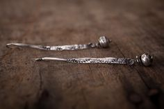Rugged stamped sticks embellished with recycled sterling silver pebbles.Drop: 2""