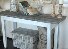 Like the pillow/sack and candle pillars, basket of books...everything. Console table simply farmhouse