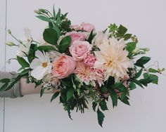 Bridal bouquet designed by @theflowercult for Academy Florists. Cafe au Lait dahlias, cosmos, lisianthus, spray roses, garden roses, wax flower, Italian ruscus, Israeli ruscus, grape ivy. Garden style wedding flowers.