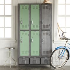 """VINTAGE LOCKER, 1960'S CABINET--American steel lockers reclaimed from high schools, factories and other venues live again, refurbished in natural steel and green meadow powder coating. Six vented door lockers sort, organize and conceal, providing a clever storage solution for large families, vacation homes, crafts and sports equipment. Three smaller drawers offer more storage below. Made in USA. 36""""W x 12""""D x 72""""H."""