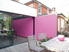 clever extension of wall and colour into garden makes space bigger