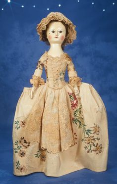 doll wearing lace-front gown of antique embroidered silks with lace trim,lace cap,antique undergarments including rare pannier hoop. English ca 1790