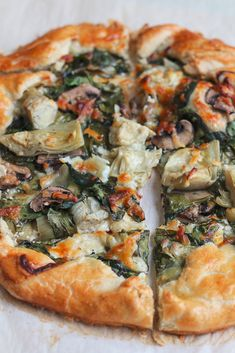 Spinach Mushroom and Artichoke Galette. So delicious and easy to make! Impress your family and friends with this savory tart. It's a perfect recipe for Easter Brunch! I can't believe Easter is about a week and a half away! In my family, we take two things Vegetarian Recipes, Cooking Recipes, Healthy Recipes, Salad Recipes, Snacks Recipes, Free Recipes, Cooking Tips, Recipies, Dinner Recipes