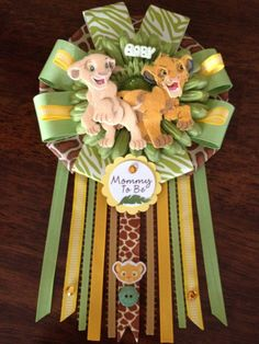 Baby Lion King Mommy To Be Corsage by AngelinaBellaFina on Etsy, $25.00 Oooh, I can make one of those! Gotta buy more lion king scrapbook embellishments!