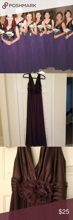 Dark purple gown I wore this beautiful dress once for my cousin's wedding. This dress zips up, is a size 8, and doesn't come with padding around the chest. There are many layers on the skirt and is easy to walk in. Dresses Wedding