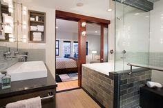 Beautiful tones of greys. Like the wood in the doors too in this Boston master bath.