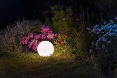Opal-colored ball of thermoplastic for an energy efficient light source, suitable for gardens. The lamp can be installed as a pendant or as a floor light after adjustment. Supplied with 170 cm power cord. Garden Floor, Energy Efficient Lighting, Garden Lamps, Opal Color, Lighting Design, Cord, Gardens, Flooring, Lights