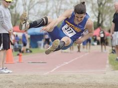 Barrie athletes take a run at OFSAA title - Scott McLaughlin of Eastview Secondary competes in long jump during the OFSAA track meet.