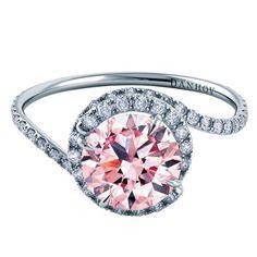 Pink sapphire and swirled pavé diamond ring by Danhov