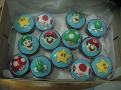 mariocupcakes.JPG - Mario, Luigi, Yoshi, Toad, 1up, Star. Chocolate cupcake covered with fondant. It took a long time, but I picked up speed by the end of making 30 of those! I wish I had some kind of template to cut shapes to make things faster.