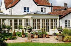 Plants in the Orangery La Houses, House Extensions, House Exterior, House Styles, Exterior Design, Colonial House, Porch Addition, Roof Design, Orangery