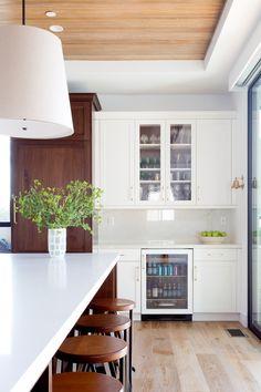 Wooden ceilings and hardwood floors in this modern kitchen design | Denton Developments