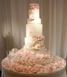 Romantic Rows of Blush and Cream Roses create a stunning base for this magnificent cake.