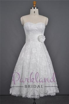 http://www.parklandbridal.co.nz/Store/tabid/4393/ProdID/33805/CatID/358/Parkland_Bridal_AmyJane.aspx  A beautiful short length lace gown with a sweetheart neckline and a beautiful sash and hand made flower at the waist. DIVINE!