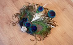 peacock feather hair piece by ShyraMichelle, via Flickr