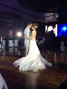 ABHL bride, Ms Vivian Chan in Galia Lahav's Giselle Gown dancing with her husband on her wedding day.