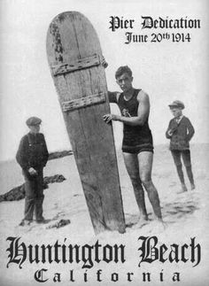 George Freeth, the first professional surfer hired by Henry Huntington to demonstrate surfboard riding to California.