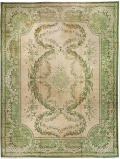 A 19th century antique Irish Donegal antique rug, the ivory field dominated by lush green leafy garland interlocked with flowering garland overall framing a floral medallion within a green garland border. Watch full size video of An Irish Donegal rug, Circa 1880, ID BB1237 - Video