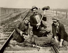 Classic image of innocent woman being tied to train tracks by very noticeably evil men. Created a cliche. I like that the characters have a distinct feel but it is very obvious and overt.