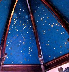 Moroccan star ceiling with tiny pinpricks of light against a rich blue background