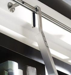 Hook library ladder offer a simple solution for those who want a sleek library ladder that can be easily repositioned to a different part of the house.