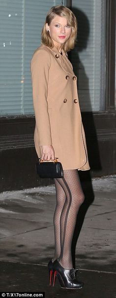 Legs eleven:Besides the tights, the pop star donned a three-quarter caramel coat that cov...