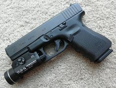 Glock 19 Gen 4 with a Streamlight Tactical Light how-we-ll-survive-the-zombie-apocalypse