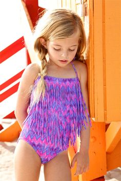The Peixoto Kids Magnolia One Piece featuring this colorful ZigZag print is on every little girls wish list. The use of this print with the fringe accents on the Designer Kids Fringe One Piece creates a unique and luxurious look. Your little fashionista will want to be wearing this one piece 24/7. #kidsdesignerswimwear