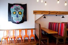 Interior Design by Robinson Home - El Camino taco shop and tequila bar. We loved merging modern with rustic in this hip restaurant. White walls, bright stripes, and a very custom car hood.