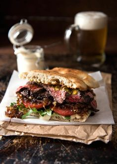 A juicy Steak Sandwich loaded with tender slices of steak, caramelised onion, garlic aioli, lettuce, tomato and mustard. recipes for two recipes fry recipes Yummy Recipes, Beef Recipes, Cooking Recipes, Healthy Recipes, Leftover Steak Recipes, Weeknight Recipes, Yummy Food, Dinner For One, Steak Sandwich Recipes