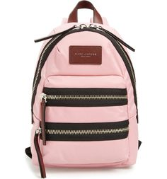Perfect for everything from commuting to weekend trips, this sized-down nylon backpack in pink is designed with exterior pockets to store your smartphone and keys for easy access.